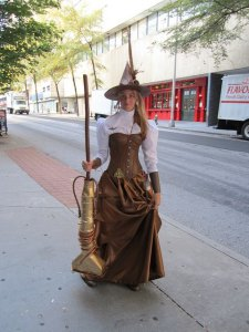 Witch with vacuum as broom